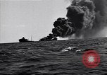 Image of sinking burning ship Atlantic Ocean off New Jersey USA, 1942, second 7 stock footage video 65675035894