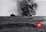 Image of sinking burning ship Atlantic Ocean off New Jersey USA, 1942, second 8 stock footage video 65675035894