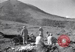 Image of Kuomintang (KMT) gunners fire field artillery and mortars at Japanese China, 1944, second 1 stock footage video 65675035896