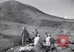 Image of Kuomintang (KMT) gunners fire field artillery and mortars at Japanese China, 1944, second 2 stock footage video 65675035896