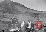 Image of Kuomintang (KMT) gunners fire field artillery and mortars at Japanese China, 1944, second 3 stock footage video 65675035896