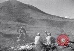 Image of Kuomintang (KMT) gunners fire field artillery and mortars at Japanese China, 1944, second 4 stock footage video 65675035896