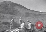 Image of Kuomintang (KMT) gunners fire field artillery and mortars at Japanese China, 1944, second 6 stock footage video 65675035896