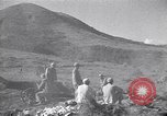 Image of Kuomintang (KMT) gunners fire field artillery and mortars at Japanese China, 1944, second 7 stock footage video 65675035896