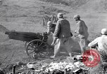 Image of Kuomintang (KMT) gunners fire field artillery and mortars at Japanese China, 1944, second 10 stock footage video 65675035896