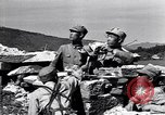 Image of Chinese Nationalist Kuomintang (KMT) forces enter Tengchong China, 1944, second 4 stock footage video 65675035898