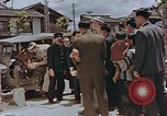 Image of black marketing by Americans Kyoto Japan, 1946, second 4 stock footage video 65675036007