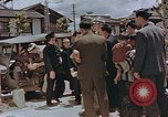Image of black marketing by Americans Kyoto Japan, 1946, second 6 stock footage video 65675036007