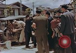 Image of black marketing by Americans Kyoto Japan, 1946, second 7 stock footage video 65675036007