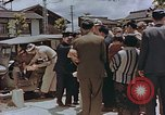 Image of black marketing by Americans Kyoto Japan, 1946, second 8 stock footage video 65675036007