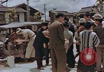 Image of black marketing by Americans Kyoto Japan, 1946, second 9 stock footage video 65675036007