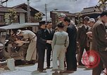 Image of black marketing by Americans Kyoto Japan, 1946, second 11 stock footage video 65675036007