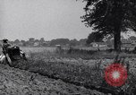 Image of man drives tractor United States USA, 1926, second 5 stock footage video 65675036592