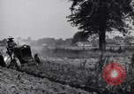 Image of man drives tractor United States USA, 1926, second 9 stock footage video 65675036592