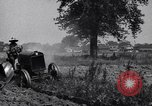 Image of man drives tractor United States USA, 1926, second 12 stock footage video 65675036592
