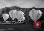 Image of Participants take off on hot air balloon race Catalina Island California USA, 1964, second 5 stock footage video 65675036642