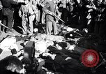 Image of dead body of Mussolini Milan Italy, 1945, second 1 stock footage video 65675036686