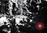 Image of dead body of Mussolini Milan Italy, 1945, second 2 stock footage video 65675036686
