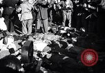 Image of dead body of Mussolini Milan Italy, 1945, second 3 stock footage video 65675036686