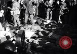 Image of dead body of Mussolini Milan Italy, 1945, second 4 stock footage video 65675036686