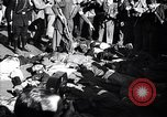 Image of dead body of Mussolini Milan Italy, 1945, second 7 stock footage video 65675036686