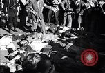 Image of dead body of Mussolini Milan Italy, 1945, second 8 stock footage video 65675036686