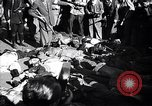 Image of dead body of Mussolini Milan Italy, 1945, second 9 stock footage video 65675036686