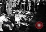 Image of dead body of Mussolini Milan Italy, 1945, second 11 stock footage video 65675036686