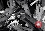 Image of death of Mussolini Milan Italy, 1945, second 12 stock footage video 65675036688