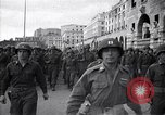 Image of Allied troops marching Genoa Italy, 1945, second 1 stock footage video 65675036691