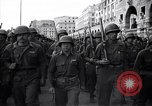 Image of Allied troops marching Genoa Italy, 1945, second 5 stock footage video 65675036691