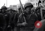 Image of Allied troops marching Genoa Italy, 1945, second 8 stock footage video 65675036691