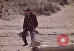 Image of fisherman Gary Indiana USA, 1970, second 11 stock footage video 65675036741