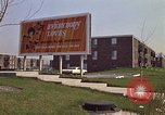 Image of billboard for Brunswick Apartments Gary Indiana USA, 1970, second 4 stock footage video 65675036749