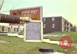 Image of billboard for Brunswick Apartments Gary Indiana USA, 1970, second 8 stock footage video 65675036749