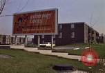Image of billboard for Brunswick Apartments Gary Indiana USA, 1970, second 12 stock footage video 65675036749