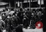Image of presentation by school children Japan, 1900, second 7 stock footage video 65675036776