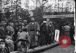 Image of man stands on wooden log Japan, 1900, second 2 stock footage video 65675036777