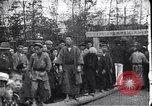 Image of man stands on wooden log Japan, 1900, second 5 stock footage video 65675036777