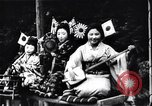 Image of women dance and play music Japan, 1900, second 5 stock footage video 65675036779
