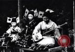 Image of women dance and play music Japan, 1900, second 9 stock footage video 65675036779