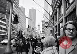 Image of People on streets of Chicago in 1960s Chicago Illinois USA, 1965, second 2 stock footage video 65675036783