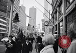 Image of People on streets of Chicago in 1960s Chicago Illinois USA, 1965, second 4 stock footage video 65675036783