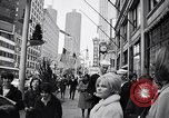 Image of People on streets of Chicago in 1960s Chicago Illinois USA, 1965, second 5 stock footage video 65675036783