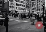 Image of People on streets of Chicago in 1960s Chicago Illinois USA, 1965, second 10 stock footage video 65675036783