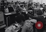 Image of Clerks process customer telephone orders in a large Chicago office Chicago Illinois USA, 1965, second 7 stock footage video 65675036792