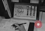 Image of women telephone switchboard workers Chicago Illinois USA, 1965, second 12 stock footage video 65675036792