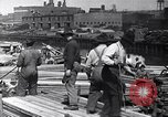 Image of immigrants working in America United States USA, 1910, second 5 stock footage video 65675036801