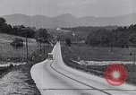 Image of early highways in America United States USA, 1932, second 10 stock footage video 65675036981