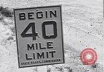 Image of signs on American highways United States USA, 1932, second 7 stock footage video 65675036982